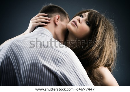 Enamoured young pair in a passionate kiss. - stock photo