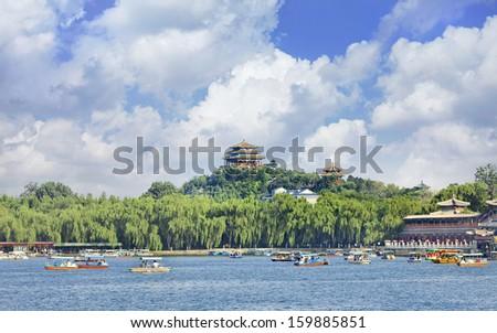 Enchanting Beihai lake with blue sky and dramatic clouds, Bejing, China - stock photo