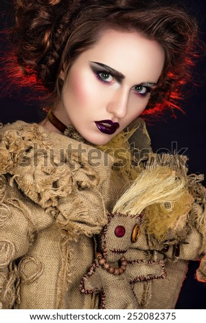 Enchanting witch woman - stock photo