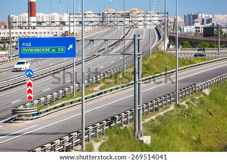Encircling highway interchange: Predportovaya overpass on the street through the ring road, St. Petersburg, Russia. Road direction marks - stock photo
