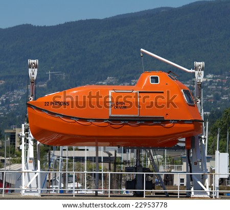 enclosed lifeboat - stock photo