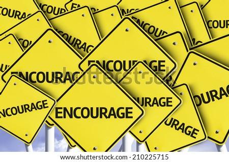 Encourage written on multiple road sign  - stock photo