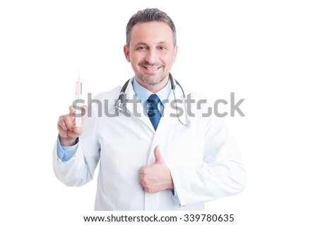 Encouraging doctor or medic holding syringe and showing like gesture smiling isolated on white background - stock photo