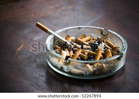 end fag , butt cigarette , ashtray grunge background - stock photo