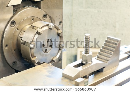 End milling with horizontal side mill machine. Metalworking, mechanical engineering, lathe and milling technology. Indoors horizontal image. - stock photo