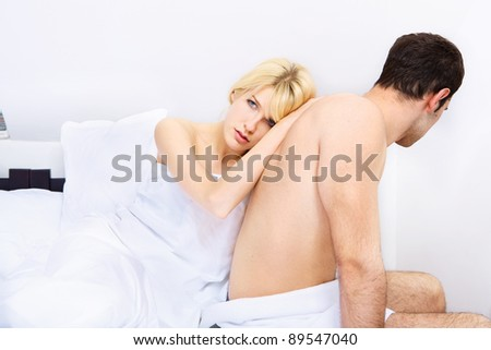 End of a young couple in bedroom, focus on female - stock photo