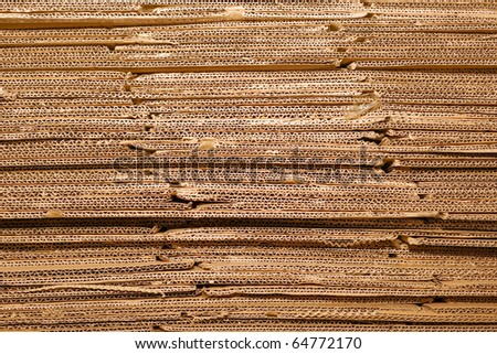 End of corrugated cardboard pile closeup background. - stock photo