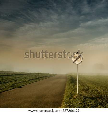 end of speed limit 50 sign with blue sky and clouds - stock photo