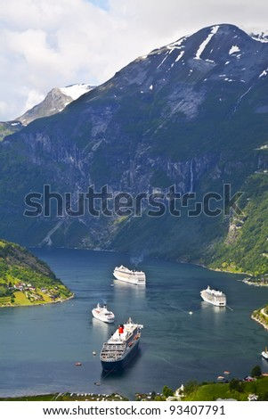 End of the famous Geiranger fjord, Norway with cruise ships - stock photo