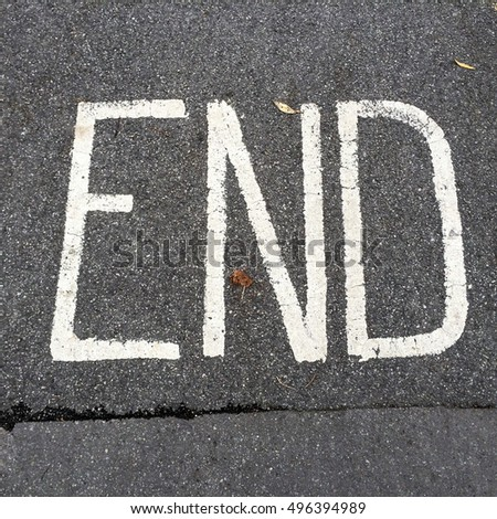END painted on road