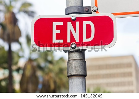 End sign on a metal pole. - stock photo