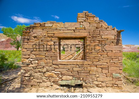 End wall of a stone house in the wilderness of Utah's southwest. - stock photo