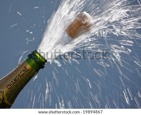 Ender corks popping open a bottle of champagne - stock photo