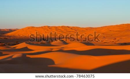 Endless Awbari Sand Sea at Sunset, Sahara Desert, Libya - stock photo