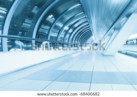 endless corridor in airport - stock photo