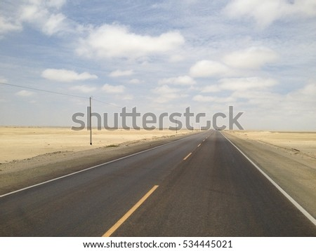 endless desert road in South America