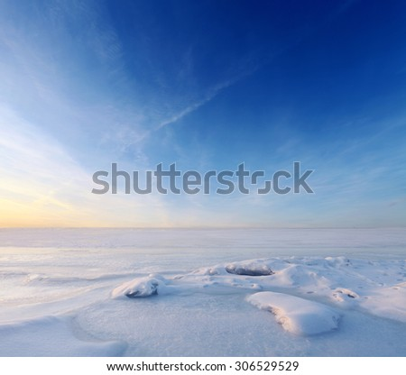 Endless frozen sea water and blue sky over horizon. Landscape at winter season - stock photo