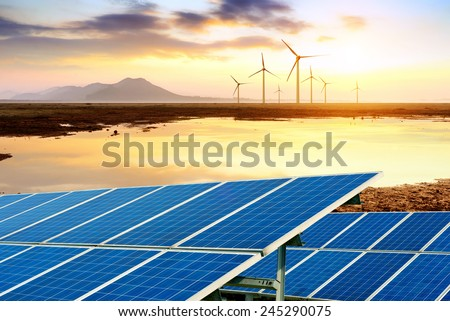 Endless prairies and lakes, wind turbines and solar panels. - stock photo