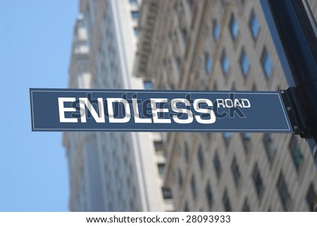 Endless road plaque in the city
