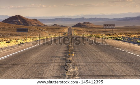 Endless roads in Arizona desert, USA - stock photo