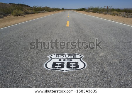 Endless roads with Route 66 sign in Arizona desert, USA  - stock photo