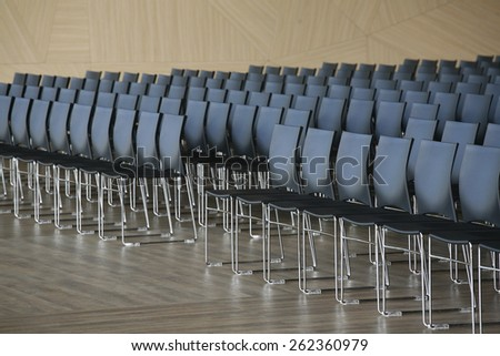 Endless rows of chairs in a modern conference hall  - stock photo