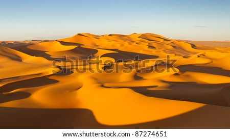 Endless sand dunes at sunset - Murzuq Desert, Sahara, Libya - stock photo