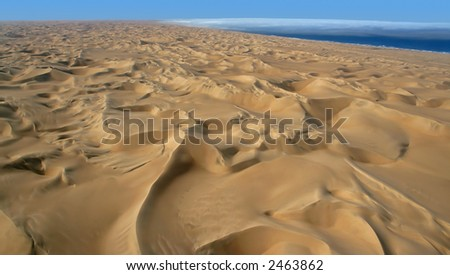 Endless sand dunes of the Namib desert along the Atlantic Coast - stock photo