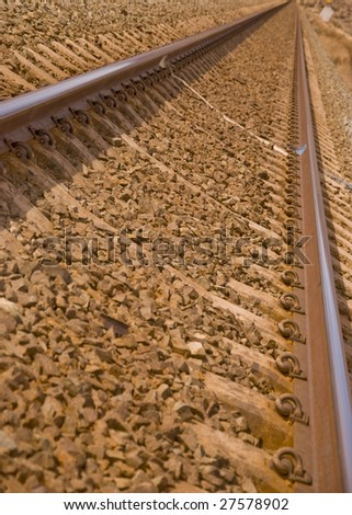 endless traintracks on a rocky bed