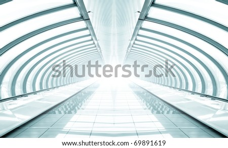 endless vanishing walkway with transparent wall in cool business center - stock photo