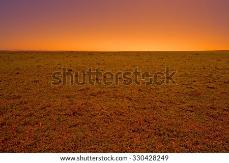Endless vast of African savannah during the sunset - stock photo