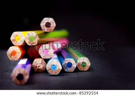 Ends of used pencils in a stack in shallow focus - stock photo