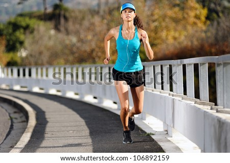 Endurance athlete training on sidewalk, running fitness marathon woman. exercise healthy lifestyle concept. - stock photo