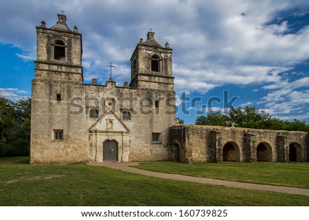 Enduring time and elements for 250 years, Mission Concepcion stands as one of the country's oldest original stone churches. In its heyday, colorful geometric designs covered its surface. - stock photo