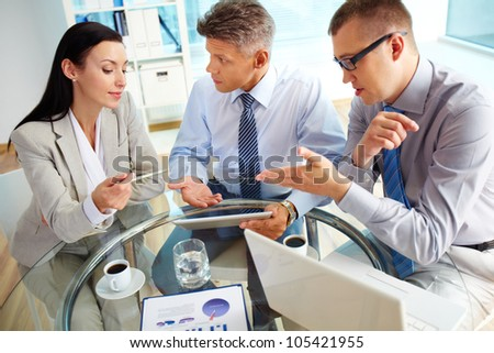 Energetic business people discussing the results of the latest strategic movements - stock photo