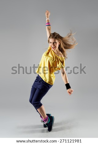 Energetic dancing woman screaming doing exercise. Young beautiful jazz girl in motion.  - stock photo
