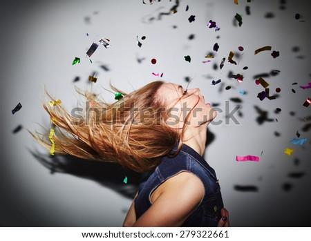 Energetic girl dancing in nightclub - stock photo