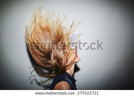Energetic girl with blond hair - stock photo