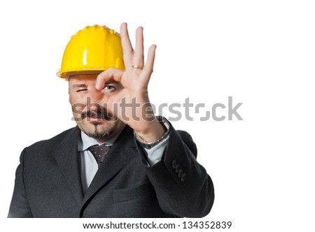 Energetic man happened on the work.  It puts on a helmet of protection.  Isolated on white background.  it marks ok.