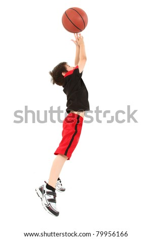 Energetic 8 year old boy child in basketball uniform jumping for shot. - stock photo