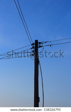 Energy and technology, electrical post with power line cables.
