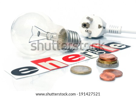 Energy Bill - Light bulb with power plug and money coins - stock photo