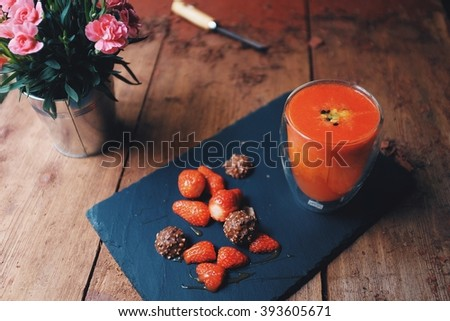 Energy booster; strawberry orange lemon and passion fruit smoothie. Soft focus on foreground. - stock photo