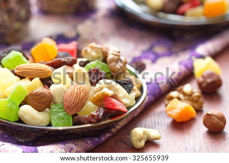 Energy break. Dried fruit and nuts. - stock photo