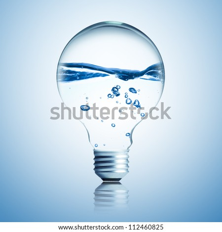 Energy concept. Light bulb with water inside - stock photo
