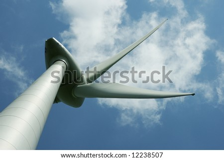 energy concept - wind turbines in beautiful summer sky, - stock photo