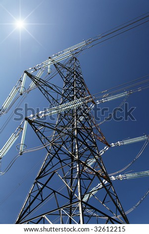 Energy concept with Sunburst over Pylon, with good detail and color - stock photo