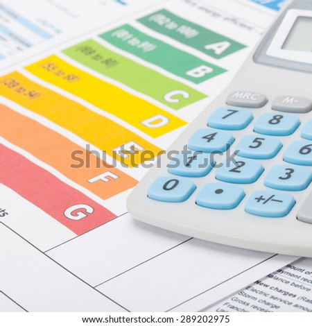Energy efficiency chart and calculator - close up studio shot - stock photo