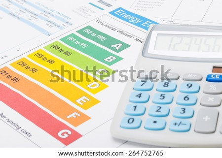 Energy efficiency chart and neat calculator - stock photo