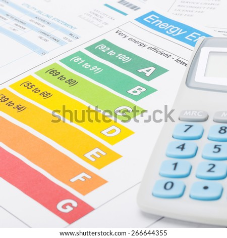 Energy efficiency chart and neat calculator - close up shot - stock photo